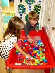 Children playing with sensory material