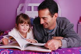 Father reading a book with his daughter