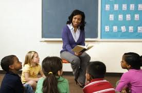 Teacher teaching children to read